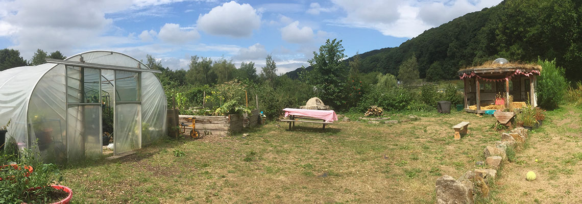 View of the Redacre social space with the poly tunnel and Round House