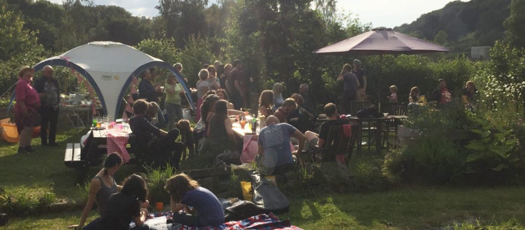 attendees of the 2019 great get together enjoying the evening sun